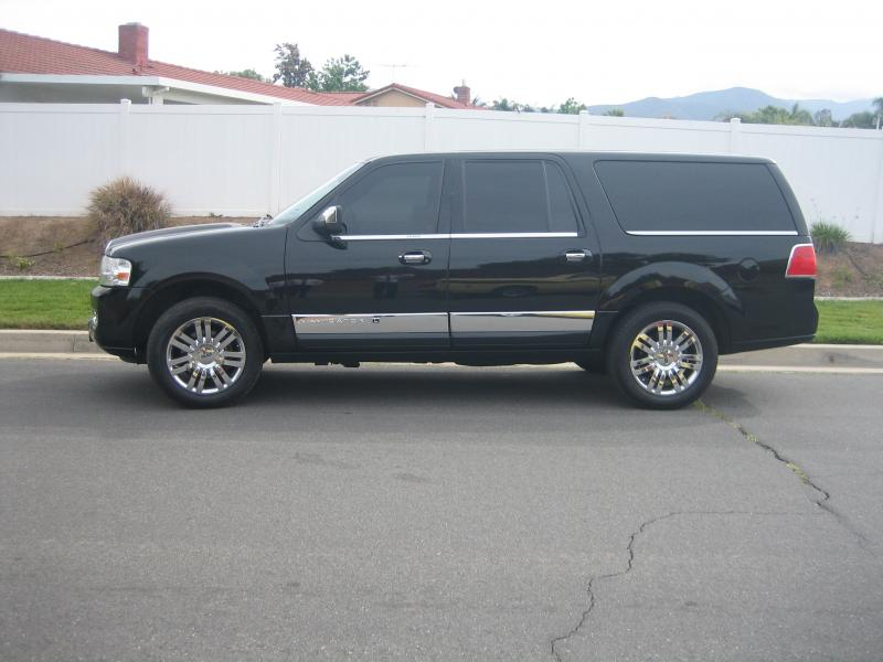 Black Navigator Limo by Coachman Enterprises Limo Service